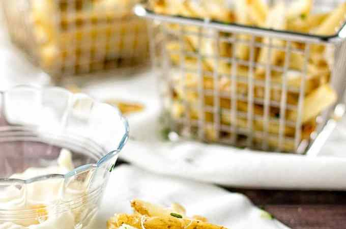 Crispy oven-baked garlic parmesan fries made with frozen french fries! | girlgonegourmet.com