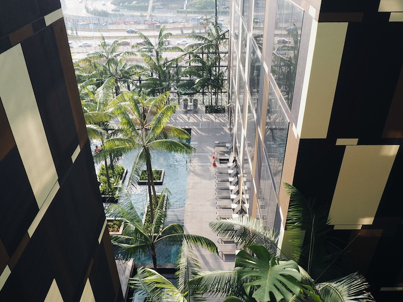 Outdoor corridors with views of the pool are a breathe of fresh air after a long flight