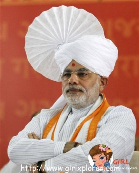 Gujarat's Chief Minister Narendra Modi wears an Indian traditional turban as he sits on the first day of his fast at a convention centre in Ahmedabad