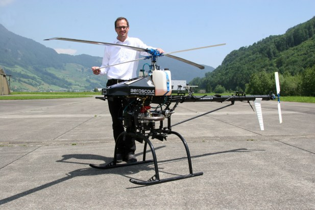 Dr. Christoph Eck, Aeroscout CEO, with their Scout UAV Helicopter