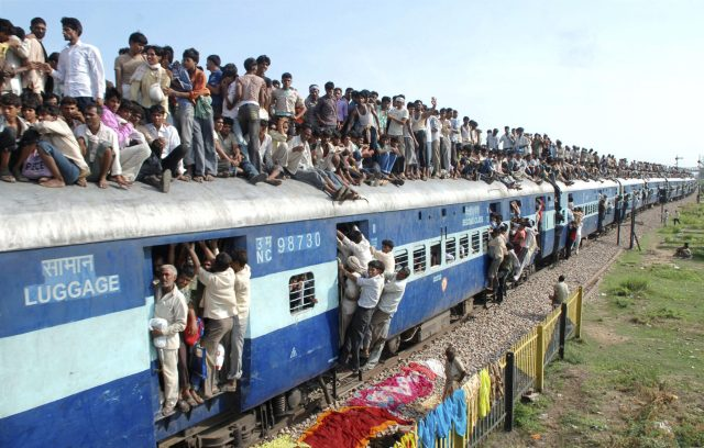 "Hindu devotees travel on a crowded passenger train to take part in the ""Guru Purnima"" festival in Goverdhan town near the northern Indian city of Mathura July 24, 2010."