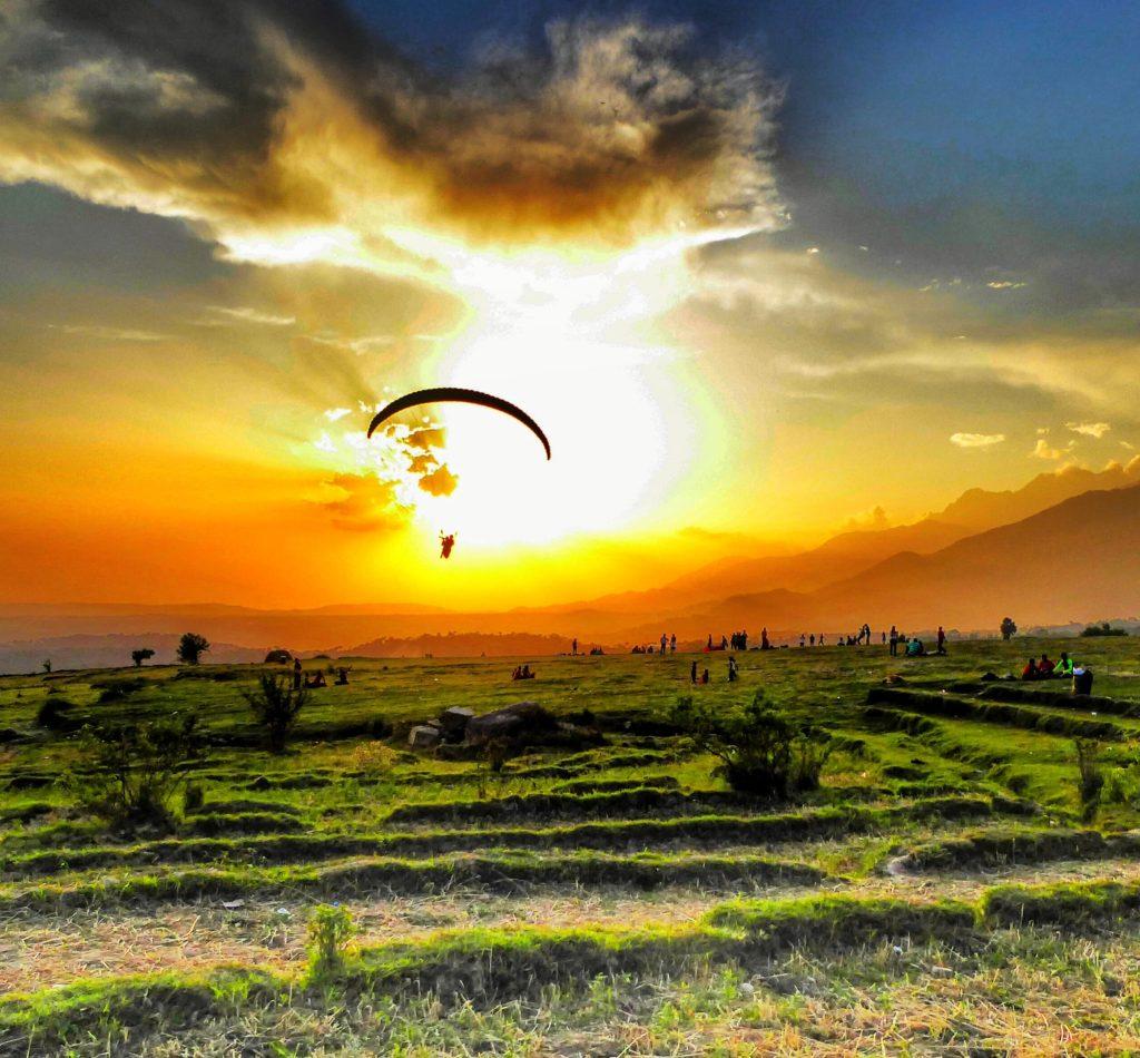 Sunset over the paragliding landing spot in Bir Billing. Himachal Pradesh, India