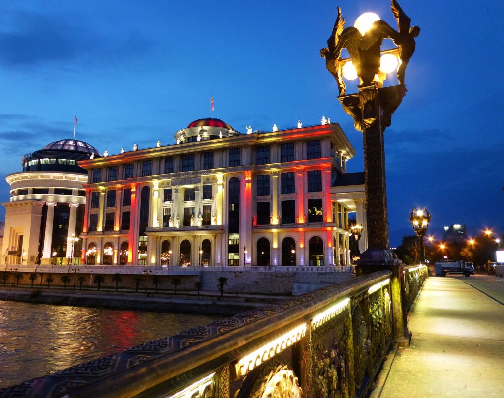 Don't miss checking out how the new buildings along the riverside look when they are lit up at night. The red and yellow are the colours of the Macedonian flag.