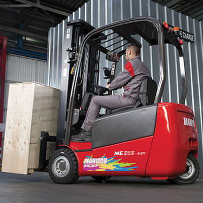 Picture showing a Manitou Lift truck carrying a load in a warehouse