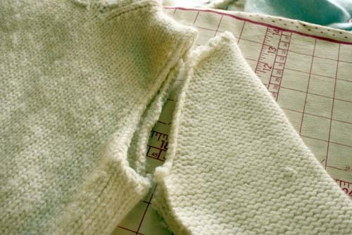 cut sleeve off of sweater along the seam