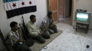 Syrian rebels watching a football match