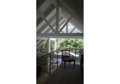 Exposed roof trusses and inside balcony with view