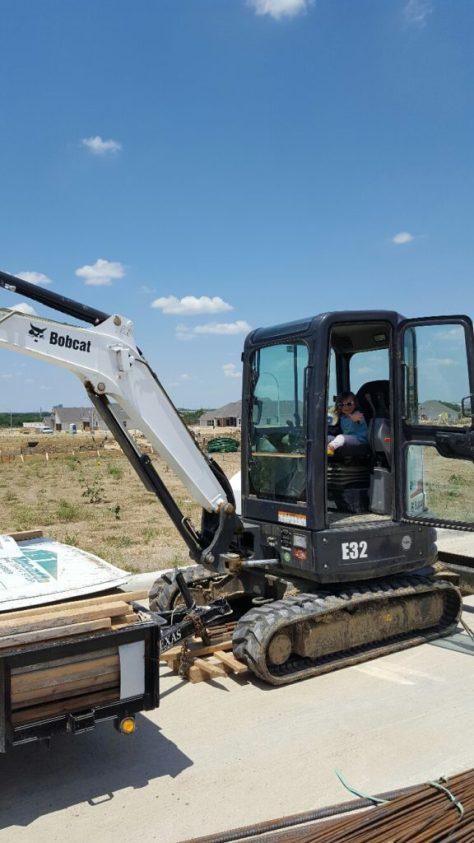 Waving in Bobcat Excavator