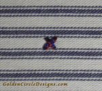 """Railroading stitches"" referring to making the strands of floss in your stitches lay parallel to each other as if they were railroad tracks."
