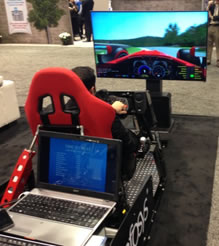 While not a giveaway (and best we can tell, also not driven by a multi-language-multi-currency core system), InfoSys seemed to make a couple fans with a Formula 1 race simulator.