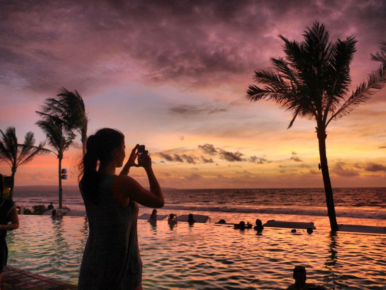 A Sun-Worshipper Watching the Sun go Down at Potato Head Beach Club - Bali, Indonesia