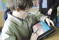 6th grader using tablet pc
