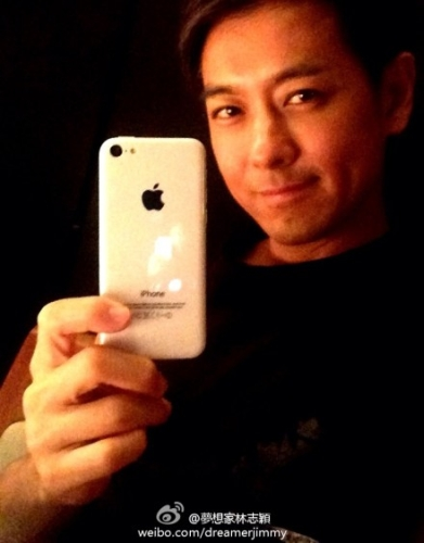 Taiwanese pop star and race car driver Jimmy Lin with the iPhone 5C.