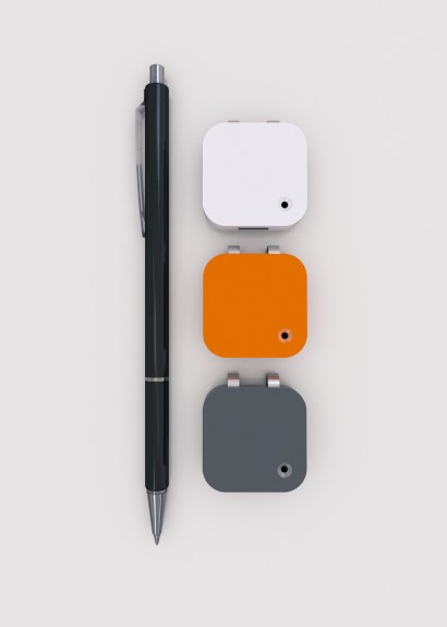 narrative clip camera next to pen