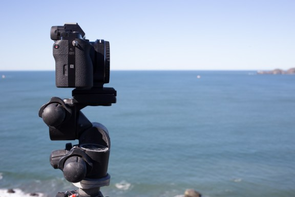 Sony A7R with Metabones EF Adapter in the field on a tripod San Francisco side view