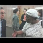 Highland Together We Stand member, Ms. Betsy, talks with pro-bono lawyer outside of the hearing room.