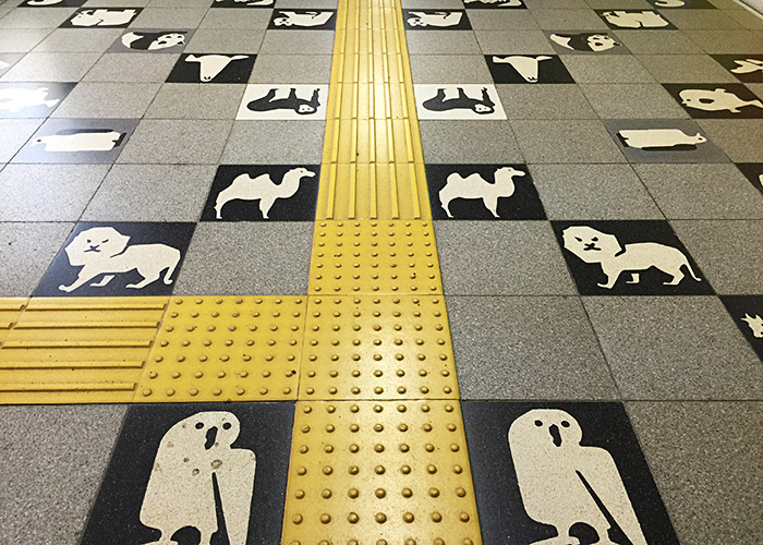Floor tiles with animals printed on them at Maruyama Koen subway station