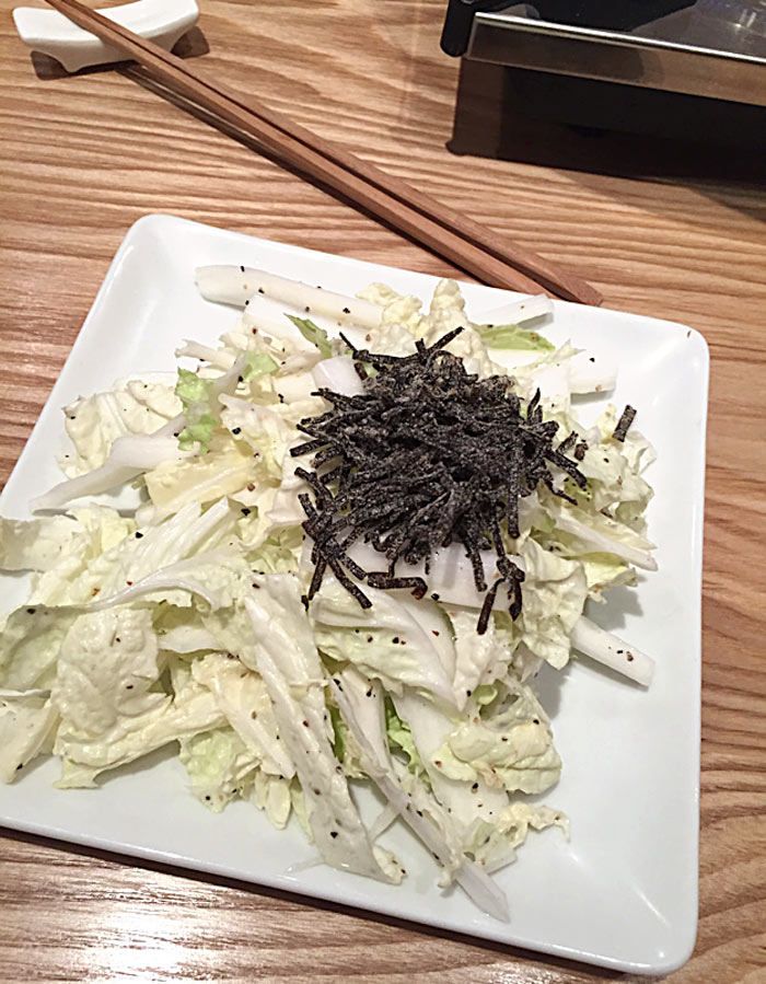 Chinese cabbage salad sprinkled with dried seaweed