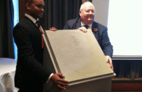 Eric Pickles unveils the design of the paving stone which will commemorate recipients of the Victoria Cross during the First World War.