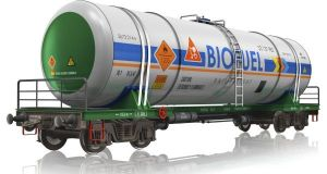 Creative abstract fuel, oil and gas industry, ecology protection technology, logistics, cargo shipping and freight railroad transportation business concept: industrial railway tankcar with biofuel isolated on white background with reflection effect