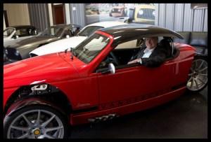 David Hall at the wheel of a Vanderhall vehicle