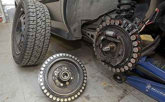 The DC brushless motor is mounted to a car's rear wheel.