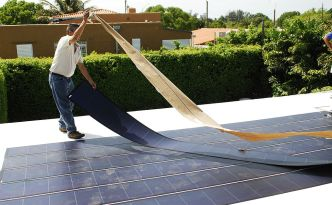 Thinfilm PV Panels being Installed on a Rooftop