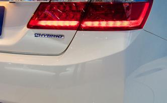 "2014 Honda Accord Hybrid is only given away by the ""Hybrid"" tag."