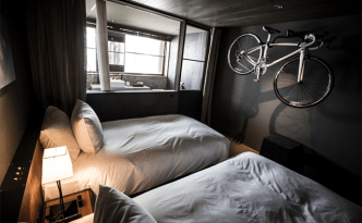 Interior of a room at Hotel Cycle in Japan where a bike is racked