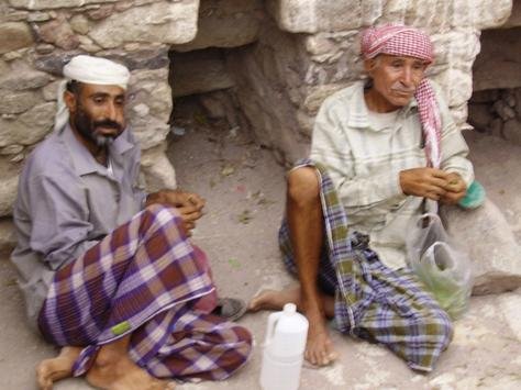 yemen men chewing qat or gat photo