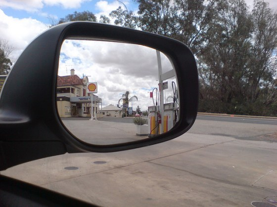 View of petrol station in car side mirror