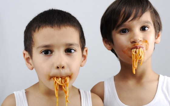 boys eating spaghetti