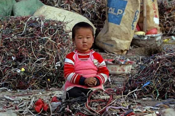 china boy child labor e-waste
