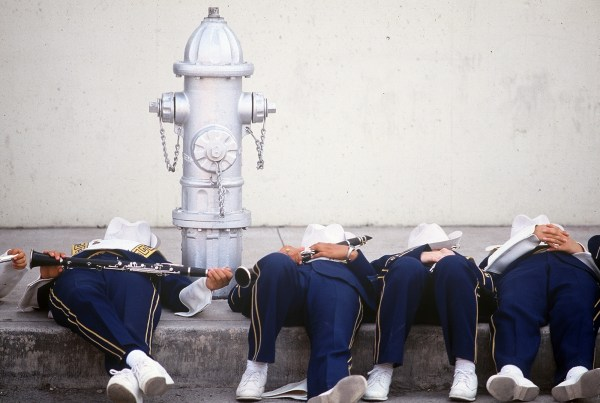 Members of a high school band rest before the Battle of Flowers Parade. It routinely attracts crowds of more than 350,000. The Battle of Flowers  is the only parade in the United States produced entirely by women, all of whom are volunteers. The original purpose of the Parade, was to honor the heroes of the Alamo.