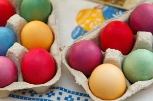 Cartons of colorfully dyed eggs