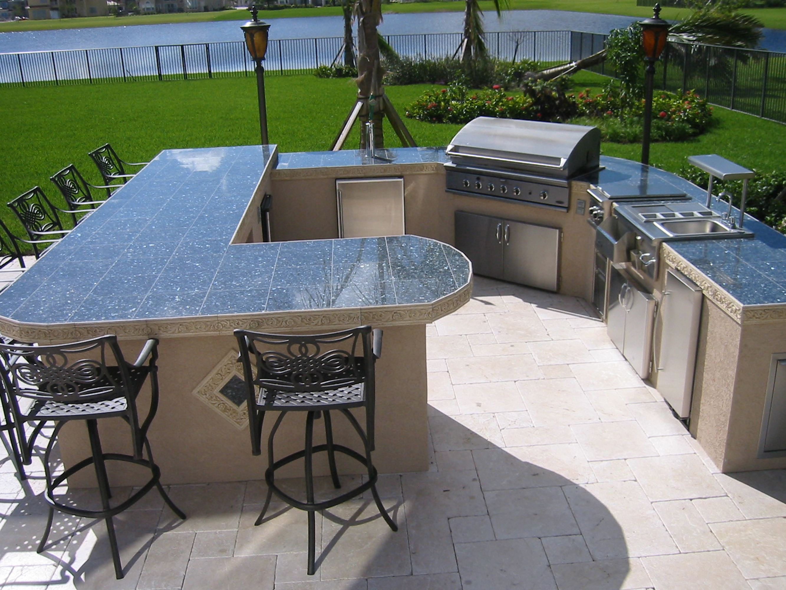 custom outdoor kitchen ideas and built in bbq grill heads for islands outdoor kitchen countertops Huge custom outdoor kitchen with built in dcs gas bbq grill and keg er