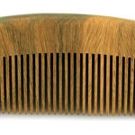 Photo of a 5 inch wooden beard comb.
