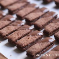Chocolate almond sticks with cardamom ganache filling