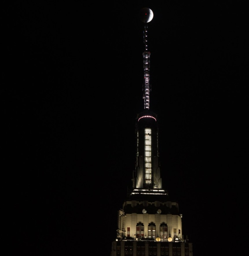 A perigee full moon, or supermoon, is seen during a total lunar eclipse on Sunday, Sept. 27, 2015 in New York City. The combination of a supermoon and total lunar eclipse last occurred in 1982 and will not happen again until 2033. Photo Credit: (NASA/Joel Kowsky)