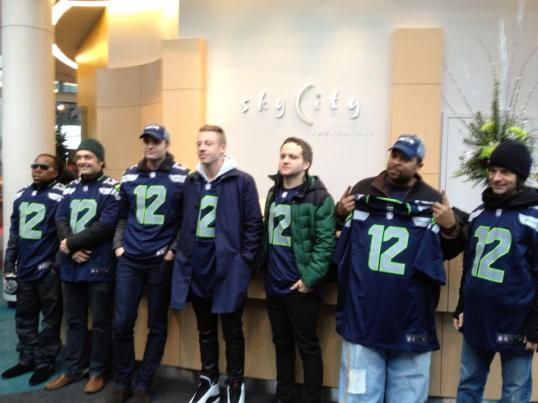 Tendai Maraire of Shabazz Palaces, Ben Gibbard, Macklemore, Jason Finn of PUSA, Sir Mix A Lot and Scott Mercado of Candlebox sporting their 12s at the Space Needle. Image from the Space Needle's twitter feed.