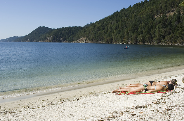 Sunbathing on the beach at Montague Harbour, Galiano Island.