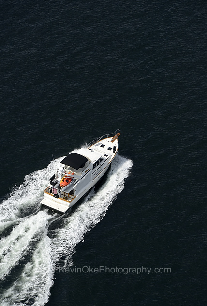 An aerial view of a motor yacht under power off the coast of Salt Spring Island