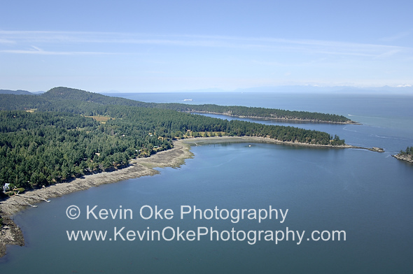 Aerial view of Bennett Bay with Campbell Point and Georgeson Island visible. The inlet of Campbell Bay is behind the peninsula, Mayne Island