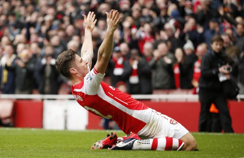 Giroud celebrates scoring a magnificent goal against Liverpool
