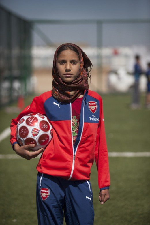 Alex Scott meets Yasmine*, 12 years old, who has been helped by the Save the Children football programme funded by Arsenal. Yasmine was forced to flee her home because of violent shelling and has been living in the camp for more than two years with her family. Yasmine said: âWhen the bombing started I was so scared. It kept getting worse and worse until we had to escape. The day we left my home was the worst day of my life; I thought we would only be gone for two days so I didnât say goodbye to my friends. Weâve been stuck in the camp for two years now and life is really hard â itâs hot and dirty and we often get sick.â The culture within the communities at the camps is extremely conservative but the football programme is playing a key role in empowering the girls â building their confidence and encouraging equality amongst all the children. Yasmine continued: âWhen the football pitch was built it was such a good day. I love going there because it makes me forget everything and I can just be happy playing with my friends. At first, the boys didnât like us playing football but now our skills have improved they respect us more. If I keep training every day I hope that one day I can be a female football player just like Alex Scott.â The Arsenal Foundation has funded two football pitches across two camps for internally displaced Iraqis to provide children living there with a safe space to play together and use football as a way to escape their tragic circumstances.