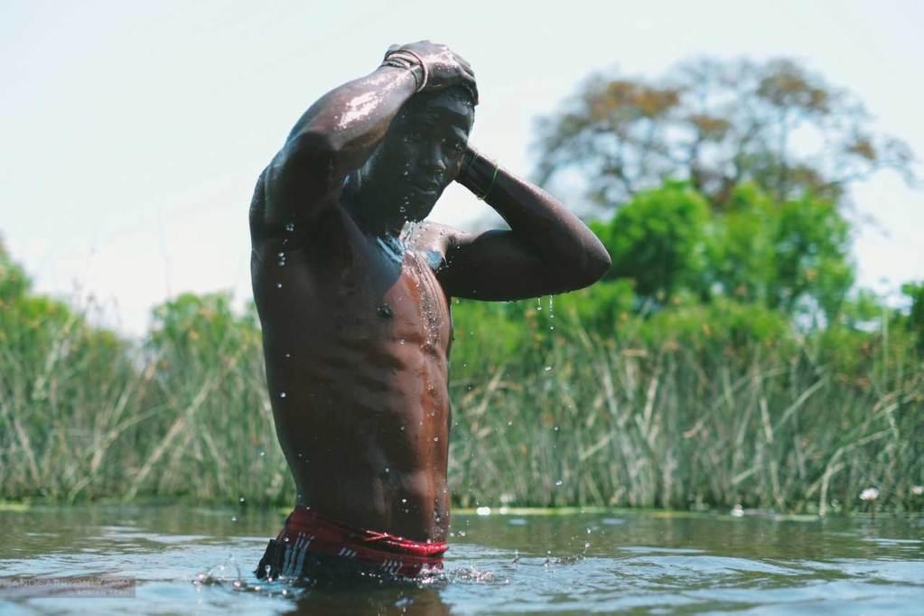 muscular african man okavango delta botswana africa