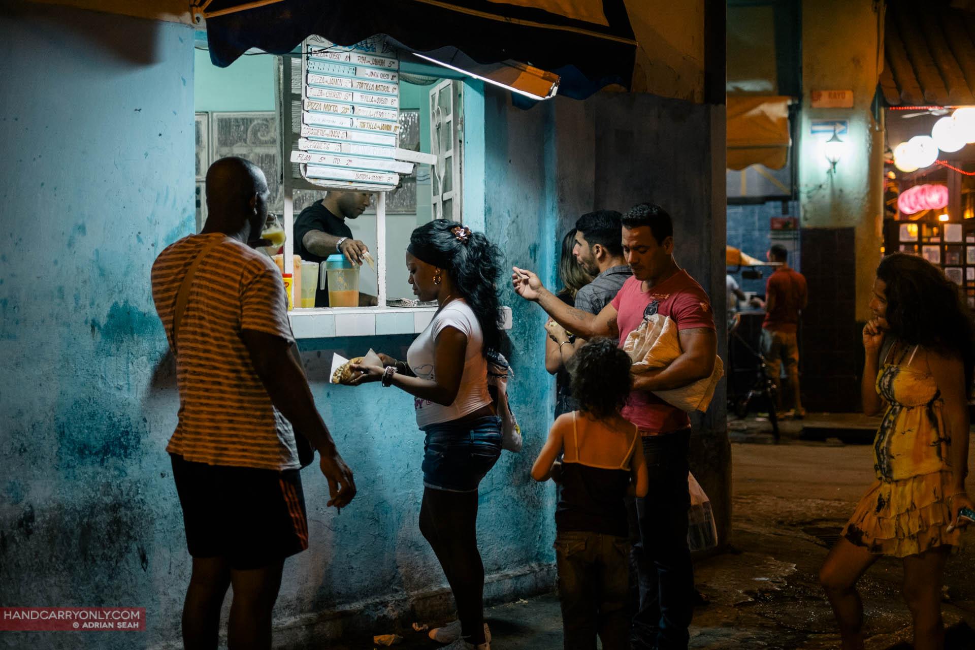 cubans buying food at night havana cuba
