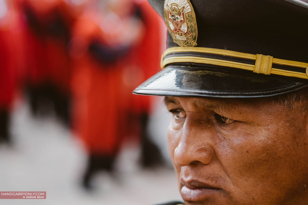Peruvian policeman keeps watch in Cusco