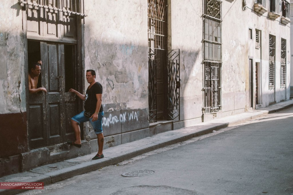 cubans chatting on the streets of havana