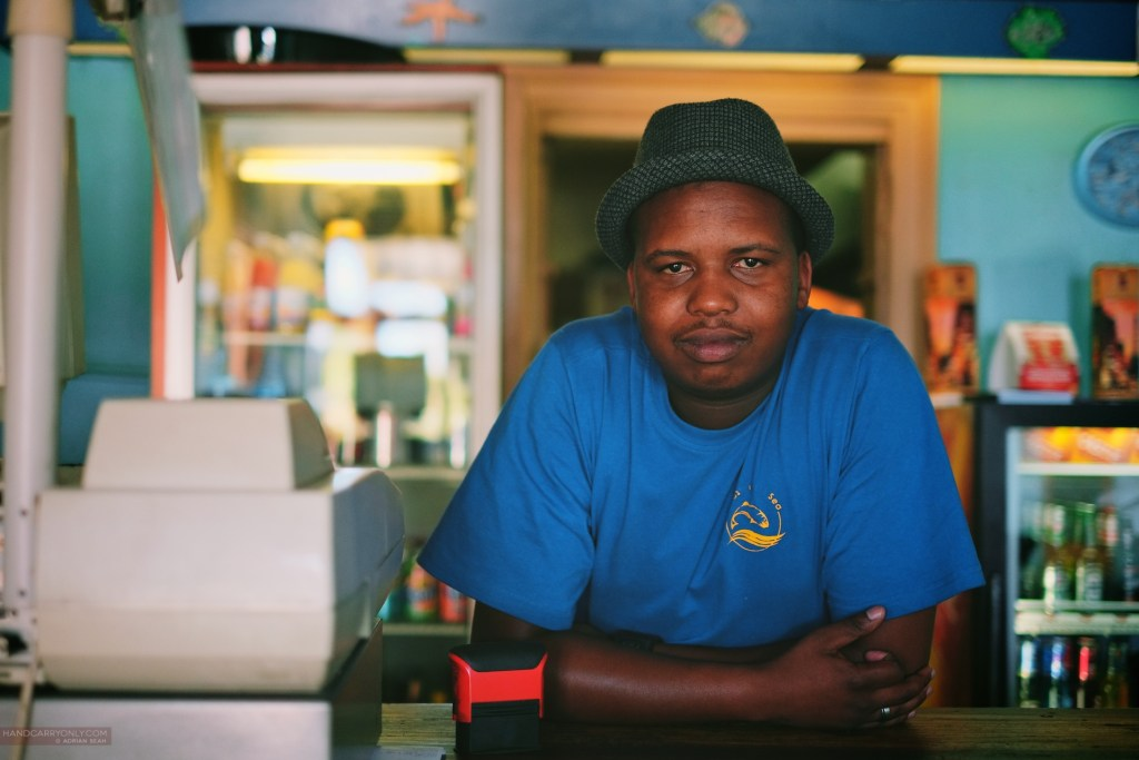 Man running a small fish and chips joint in Ladybrand, South Africa. Fujifilm XF 35mm